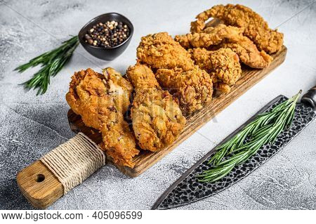 Delicious Crispy Fried Breaded Chicken Parts. White Background. Top View