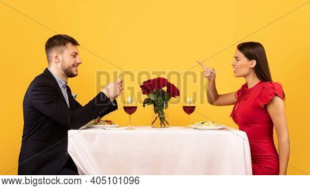 Jealousy In Relationship. Jealous Girlfriend Shouting At Boyfriend While He Using Mobile Phone Suspe