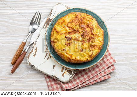 Homemade Spanish Tortilla - Omelette With Potatoes On Plate On White Wooden Rustic Background Top Vi