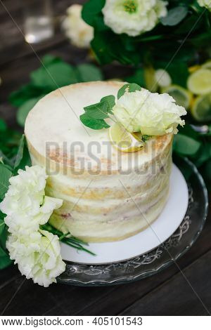 Cake With Lemons, Lime Cake,wedding Yellow Cake. White With Yellow Cake, Decorated With Fresh Flower