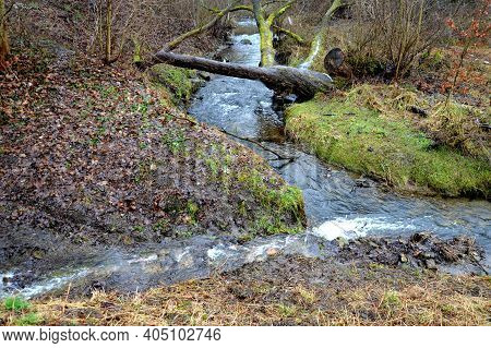 Flooded Stream Led To A Narrow Riverbed Where The Water Drains Quickly, The Bends Must Be Laid Out W
