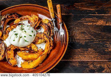 Cheese Burrata Mozzarella With Baked Pumpkin. Dark Wooden Background. Top View. Copy Space.