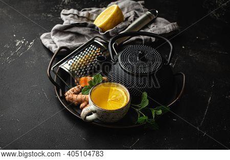 Healthy Warm Herbal Turmeric Tea For Boosting Immune System. Ingredients For Making Detox Tea In Cup