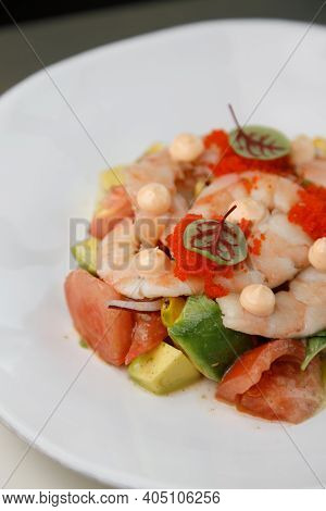 Shrimp Salad Close-up. Shrimp With Tomato, Avocado, Pickled Onion And Flying Fish Roe.