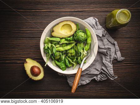 Green Healthy Salad With Spinach, Brussels Sprouts, Avocado In Bowl And Green Detox Smoothie In A Bo