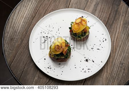 Eggs Benedict With Vegetables. Poached Egg Toast