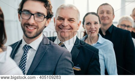 Close Up. A Team Of Experienced Employees Standing In Line