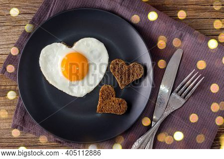 Valentines Day Breakfast With Heart Shaped Fried Eggs Served On Grey Plate And Napkin. Flat Lay, Top