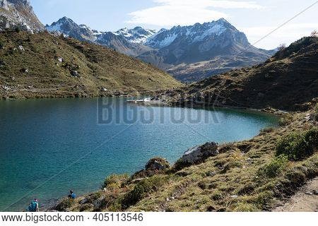 A Beautiful Blue Mountain Lake With View To The High Alpine Swiss Region