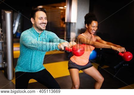 Attractive Sports People Friends Are Working Out In Gym