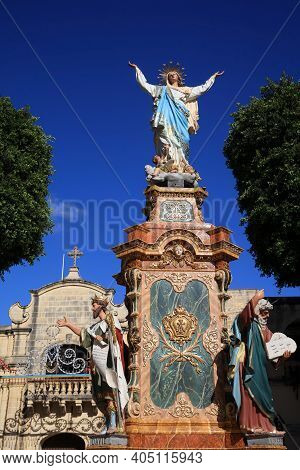 Victoria, Malta - August 15, 2019: Statue In Front Of Cathedral Of The Assumption In Victoria. Gozo.