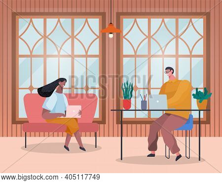 Creative People Working In Co Working Office. Man And Woman Sitting In Room Typing On A Laptop. Mana