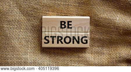 Be Strong Symbol. Wooden Blocks With Words 'be Strong'. Beautiful Canvas Background. Copy Space. Mot