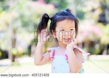 Adorable Little Child Girl Ran Around And Smiled Sweetly. Children Are Fluent In Green Nature. A 3 Y