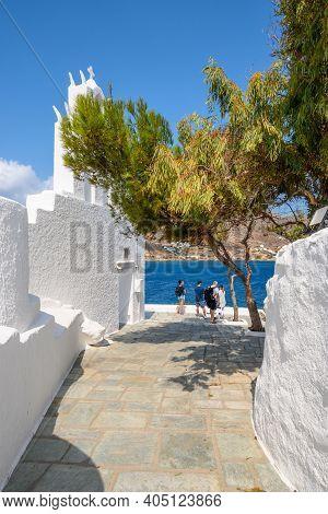 Ios, Greece - September 22, 2020: Tourists Visit The Church Of Agia Irini (saint Irene) Near The Por