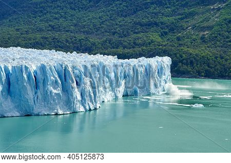 Blue Ice Of Calving Perito Moreno Glacier In Glaciers National Park In Patagonia, Argentina With The