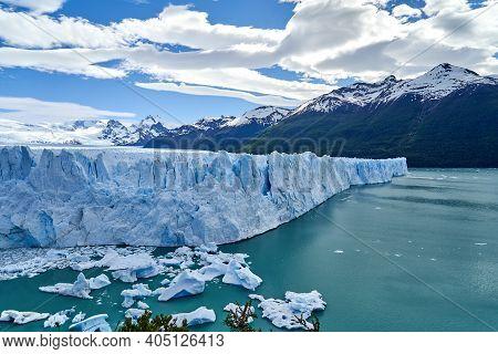 Blue Ice Of Perito Moreno Glacier In Glaciers National Park In Patagonia, Argentina With The Turquoi