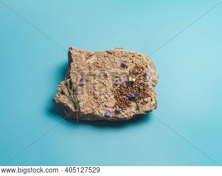 Flax Seeds And Flax Oil On Stone. Brown Linen Seeds, Flaxseed Oil And Blue Flax Flowers On Old Gray