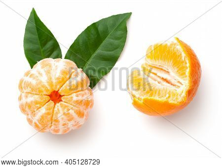 Peeled Mandarin Orange With Green Leaves Isolated On White Background. Clementine, Tangerine. Top Vi