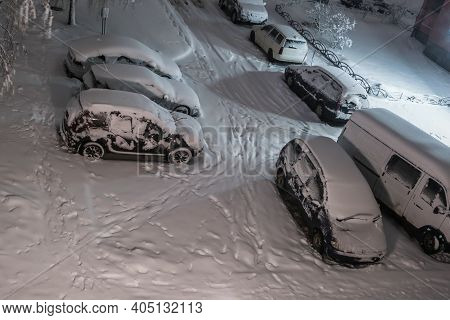 Snow-covered Overnight Parking In The Courtyard Of A Multi-storey Area