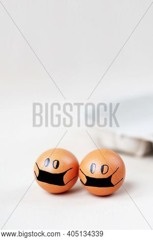 Chicken Eggs With Drawn Medical Mask With Egg Carton On White Background. Easter Eggs Holidays Decor
