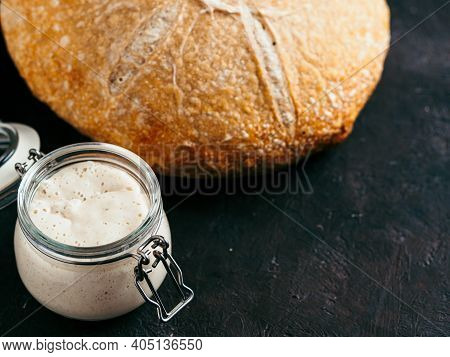 Sourdoug Starter And Wheat Sourdough Bread. Wheat Sour Dough Starter In Glass Jar And Delicious Home