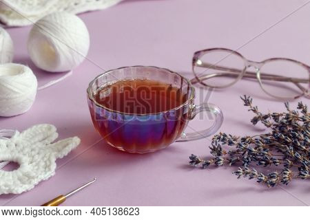 A Cup Of Tea With A Saucer, Lavender Branches, Needlework Made Of White Yarn, Close-up-the Concept O