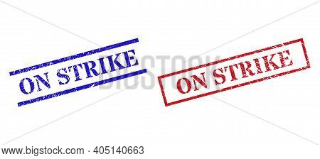 Grunge On Strike Rubber Stamps In Red And Blue Colors. Seals Have Rubber Texture. Vector Rubber Imit