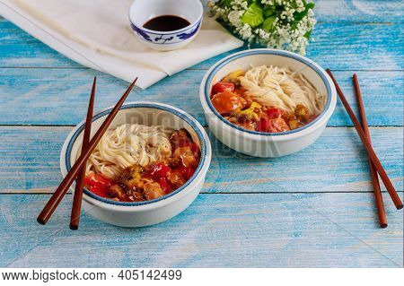 Japanese Noodles With Stir Fry Vegetable In Bowl With Chopsticks. Chinese Food.