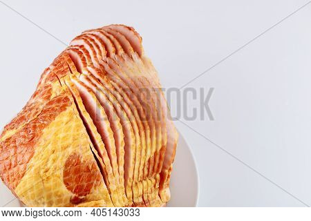 Whole Spiral Sliced Hickory Smoked Pork Ham Isolated On White Background.