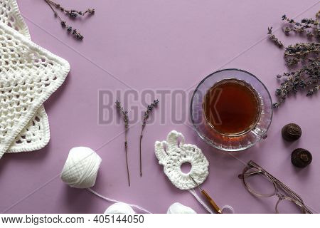 A Cup Of Tea With A Saucer, Lavender Branches, Needlework Made Of White Yarn, Top View, A Place For