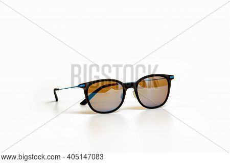Conceptual Elegant Sunglasses Isolated On White Background. Sun Glasses Summer Accessories As Design