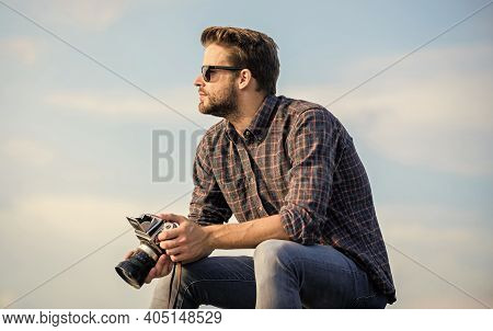 Guy Outdoors Blue Sky Background. Vintage Equipment. Reporter Taking Photo. Hipster Photographer. Bl