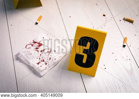 Bloody Napkin, Stubs And Crime Scene Marker On White Wooden Table
