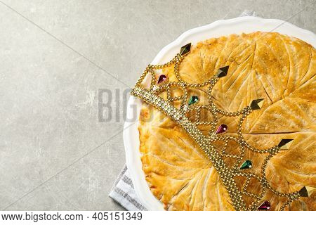 Traditional Galette Des Rois With Decorative Crown On Light Grey Table, Flat Lay. Space For Text