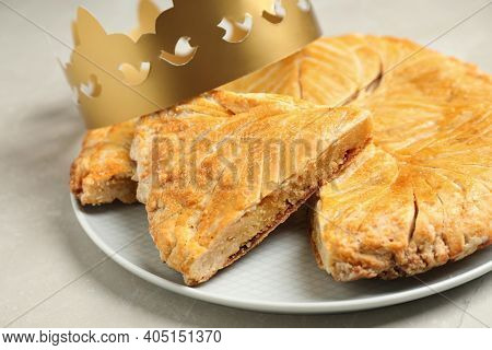 Traditional Galette Des Rois With Paper Crown On Light Grey Marble Table