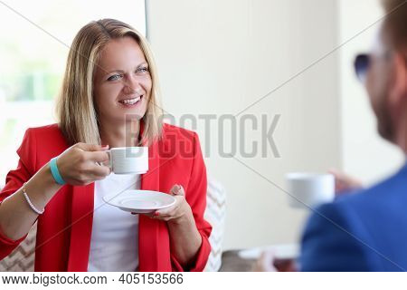 Smiling Woman And Man Drinking Coffee. How To Behave At The First Meeting Concept