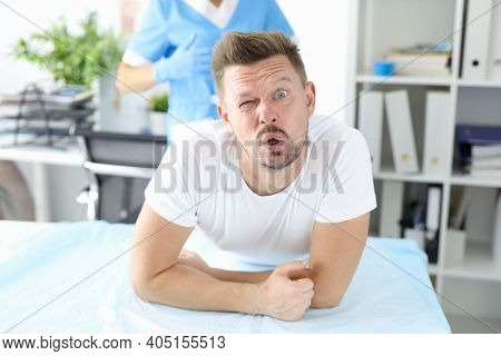 Surprised Man Undergoes Medical Examination By Proctologist. Bowel Disease In Man Concept