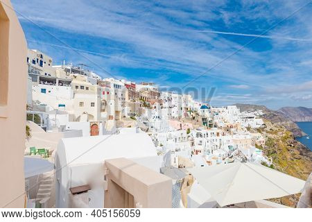 Famous Europe Travel Destination. Oia Village In Santorini. White And Colorful Architecture Houses W