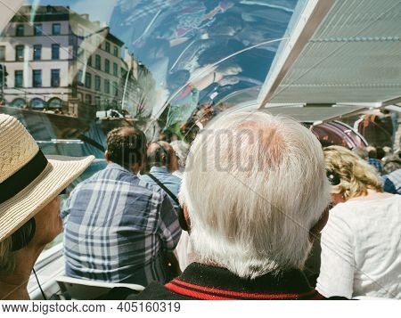 Rear View Of Young Seniors Passengers Tourists Sightseeing Through Large Glass Windows Of Batorama T