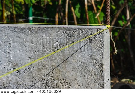 New Concrete Blocks And Curbs For Road Construction On Sand, Laying Roads Or Sidewalks.