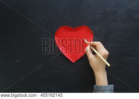 Hand Of Girl Writing Love Letter On Valentine Day. Handmade Red Heart Postcard. Woman Write On Postc
