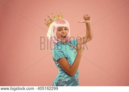 Happy Girl Crown Pink Background. Coronate Symbol. Coronavirus Made In China. Chinese Child In Kimon