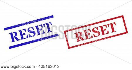 Grunge Reset Rubber Stamps In Red And Blue Colors. Stamps Have Draft Surface. Vector Rubber Imitatio