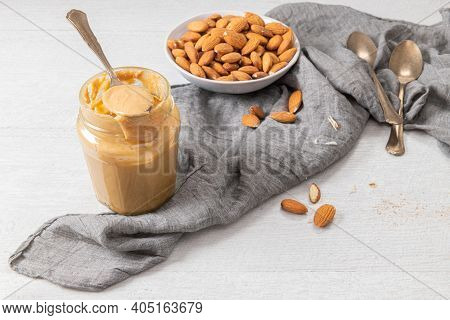 Almond Butter, Raw Food Paste Made From Grinding Almonds Into Nut Butter, Crunchy And Stir, White Wo