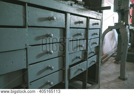 Old Metal Boxes At An Abandoned Factory. Workplace At An Old Abandoned Factory.