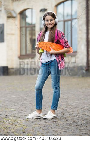 Just Skate. Happy Kid Hold Penny Board Outdoors. Skateboarding Fun. Cruiser And Transportation. Extr
