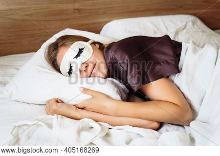 A Young Beautiful Woman Is Sleeping In Her Bed With A Sleep Mask Against A Bright, Annoying Light. R