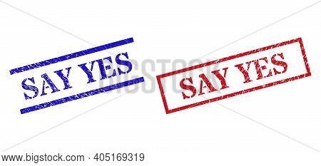 Grunge Say Yes Stamp Seals In Red And Blue Colors. Seals Have Rubber Style. Vector Rubber Imitations
