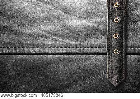 Background Photo Of A Black Leather Texture With Belt Strap.